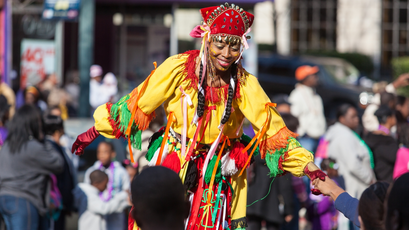 A stilt walker performs during the annual Krewe of Harambee Martin Luther King Day Mardi Gras Parade in downtown Shreveport.