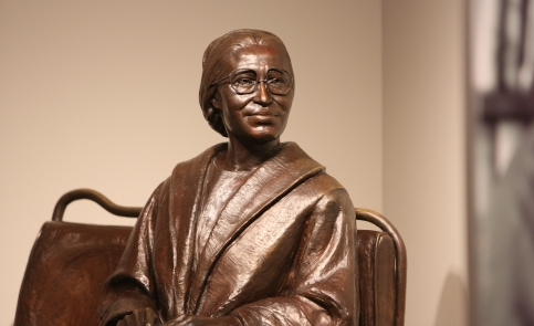 Take a photograph of yourself seated on the bronze statue bus seat next to Rosa Parks at the Rosa Parks Museum.