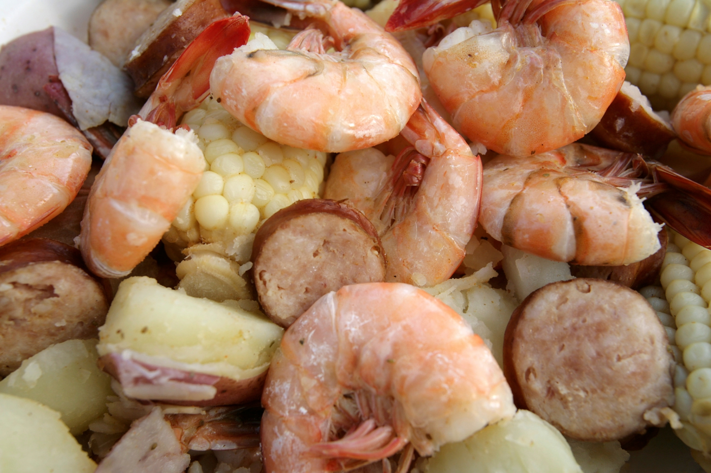 Beaufort stew, otherwise known as Frogmore stew, is a local favorite! It's a delicious combination of boiled shrimp, corn, potatoes and kielbasa sausage.