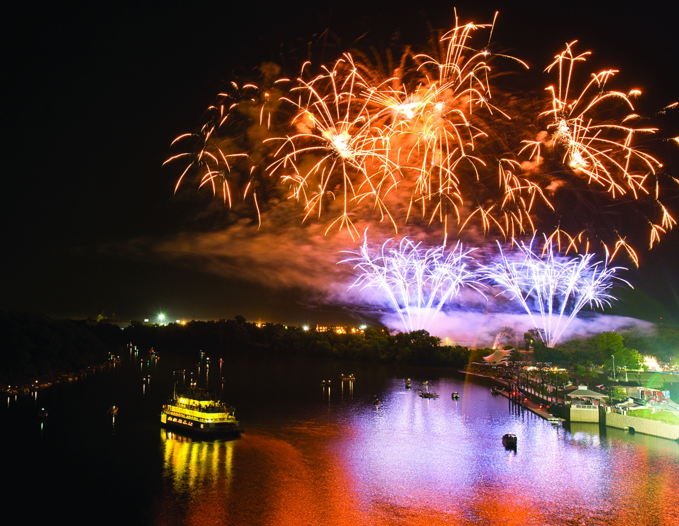 Fireworks light up the sky along the Alabama River beside one of America's most historic cities.
