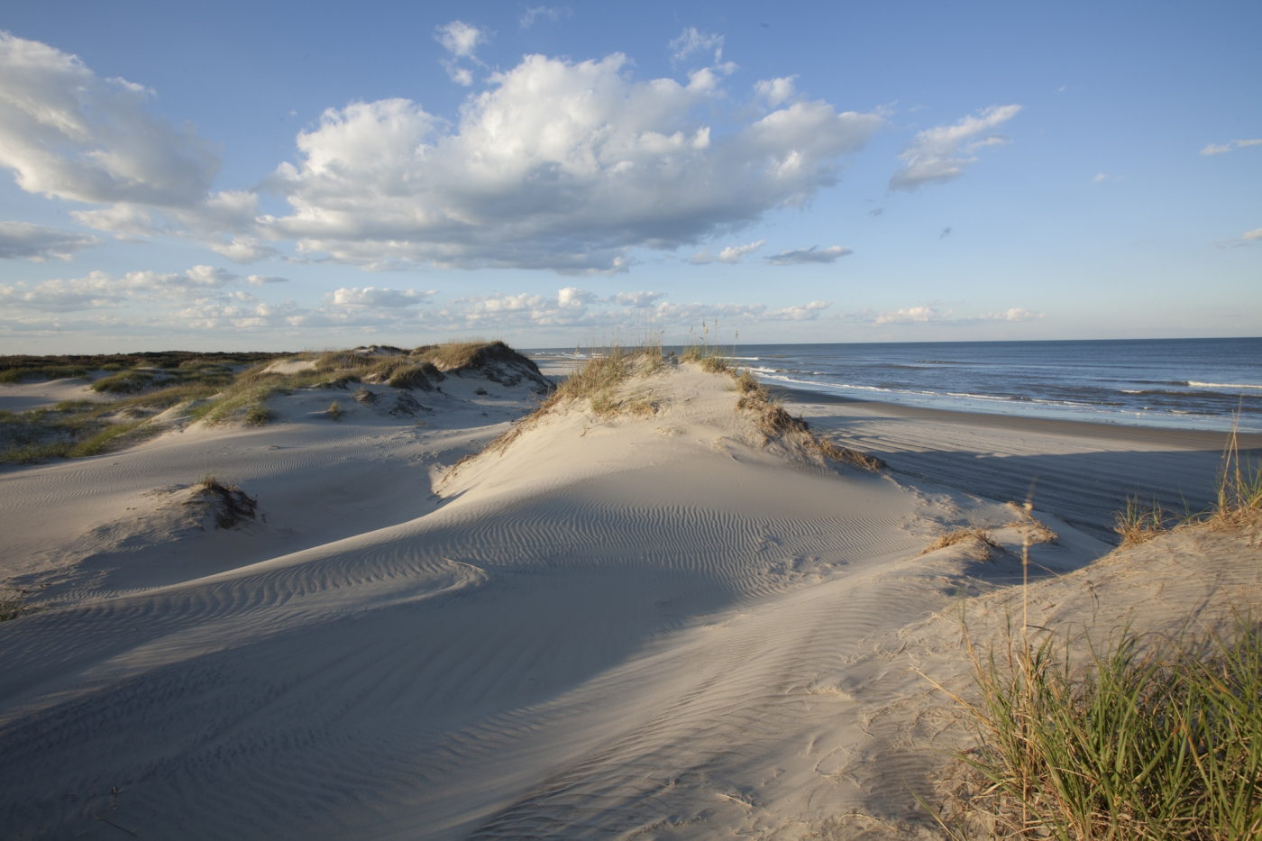 North Carolina's 300 miles of barrier island beaches beckon visitors near and far.